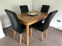 Oak veneer table and 4 faux leather chairs