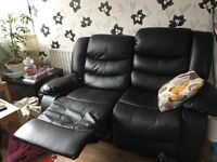 Free two and three seater settees black leather must be picked up Sunday 14/8