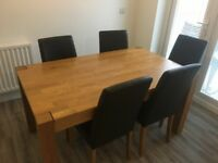 Wooden dining table and 5 chairs