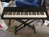 Casio Electronic keyboard with stand for sale
