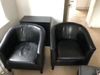 Two black armchairs