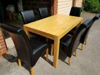 Wooden Dining Table with 6 Faux Leather High Back Chairs