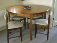 Teak table & 4 chairs and matching sideboard excluding ornaments