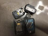 Two makita batteries and charger