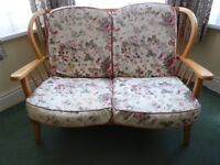 Retro 1970's Ercol-style 3 piece suite in blond wood. Cushions with fire safety labels.