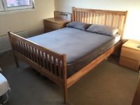 Bed frame with mattress and two pillows