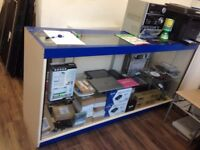 big glass counter and glass stand ( good offer)