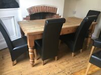 Antique pine solid table with 6 faux leather black chairs