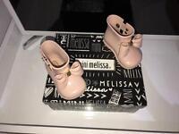 Mini Melissa boots.