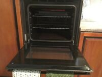 Built in double electric fan oven and halogen hob