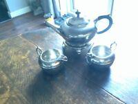 Silver plate tea set consisting, teapot, milk jug, sugar basin and teapot stand