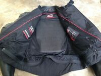 Leather motor cycling jacket with built in protection. Excellent condition