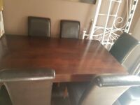 Solid wood table and 6 faux leather chairs