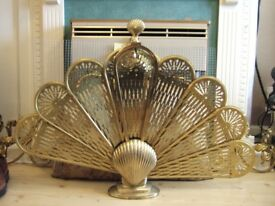 Antique brass fire guard. Attractive fan shaped fire guard.
