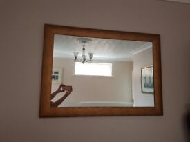 Curved frame mirror