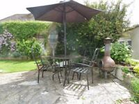 Garden / Patio table, four chairs and parasol