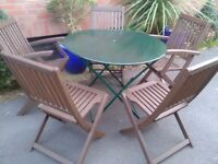 Garden metal folding table and 5 x wooden folding chairs in good condition