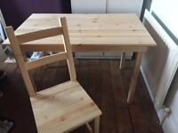 Ikea pine table and four chairs very good condition year old