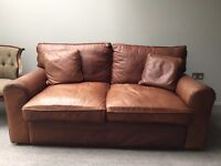 Leather brown sofa, plus 2 leather cushions.