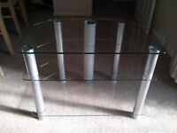 Glass television stand with chrome legs