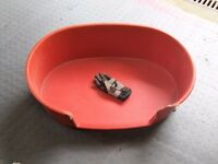 Large red plastic dog bed - free to collector