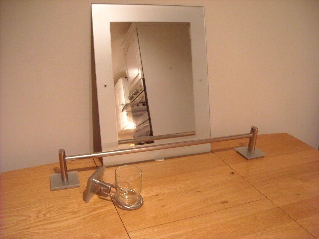 Bathroom mirror. Towel rail & toothbrush/paste holder