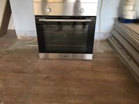 LOGIK single fan oven - brushed chrome