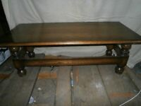 Dark wood coffee table in good condition (Heavy solid wood)