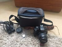 Canon 600D (18-55m lens), with battery, charger, SD card and Strap (some light cosmetic damage)