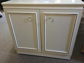 Solid white cabinet with gold trim