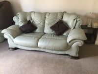 LEATHER THREE PIECE SUITE AND FOOT STOOL