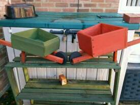 Wooden garden wheelbarrow planters