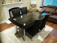 BLACK/ GLASS DINING TABLE AND CHAIRS