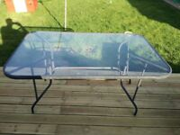 Glass top table seats 6-8. 150x96cm. 74cm high. Some rust but still solid and in good working order.