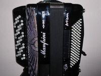 Manfrini 96 Bass, 4 voice Cassoto 5 row button key accordion.