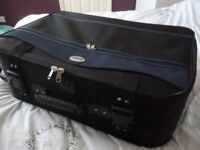 large suit case (70 cms by 50 cms) very good suit case ,has four wheels only £19,stanmore,middx...