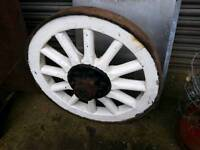 2 old cart wheels