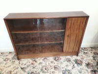 old brown wood display cabinet with glass sliding doors