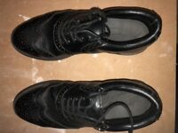 Pair of size 8 men's golf shoes