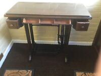 Sewing table with singer treadle base
