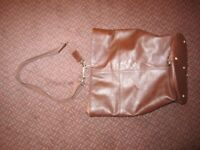 Pell-Mell Accessories – large brown leather holdall in good condition.