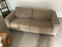 Brown canvas sofa for free