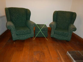 Two wing back green armchairs for sale