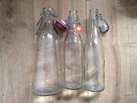 3 vintage clip glass bottles