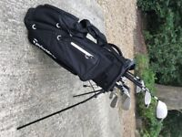 NICE SET OF TAYLORMADE GOLF CLUBS INCLUDING BAG, WOODS, HYBRID, IRONS, PUTTER
