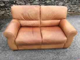 Two seat leather sofa and footstool