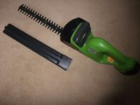 Cordless, battery powered hedge trimmer.