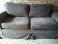 Chocolate brown, material 3 seater sofa. Free if you can collect from our garage.