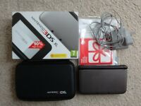 Nintendo 3DS XL boxed with charger and case. MINT