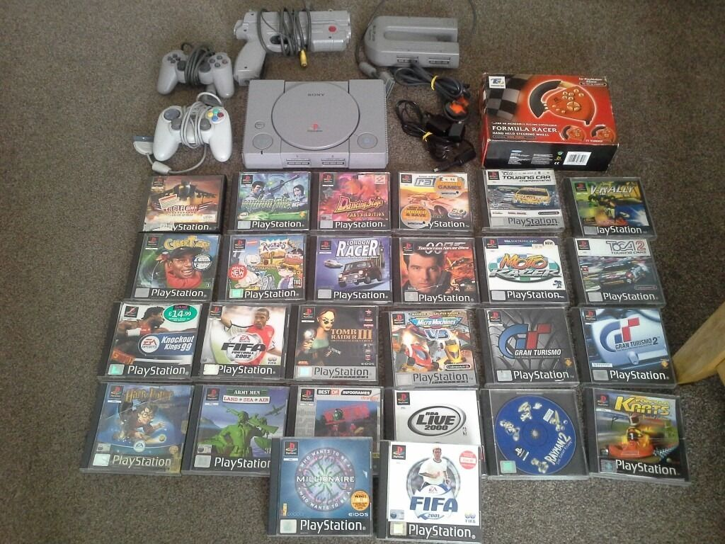 Playstation 1 ps1 2 controllers, boxed steering wheel, namco gun, multitap26 gamesin Luton, BedfordshireGumtree - Playstation 1 with a boxed steering wheel, 2 controllers with a multitap adapter and 26 games. I cannot test the gun as they only work on the older style tvs, large collection for sale. Comes with av lead and power cable. Some of the disks have some...